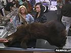 Two hot babes sell a moose head to the pawn shop