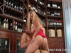 Chesty mom humping cock in the library
